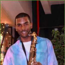 Performing on the tenor saxophone with the Dominant Seventh Jazz and Calypso Band (2014).