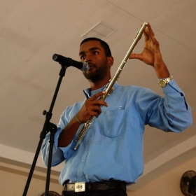 Demonstrating and lecturing about the flute at St. Augustine high school (2015).