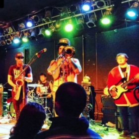 Opening for Pete Francis and Chad Stokes of Dispatch on Halloween 2015 with the Funky Dawgz Brass Band (I'm the guy in the Santa suit)