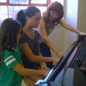 Teaching piano & voice to siblings in the church studio! : )