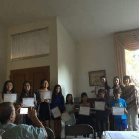 Students displaying their Performance Certificates at the Recital