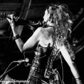 Playing 5-string electric violin on stage with Buckstein