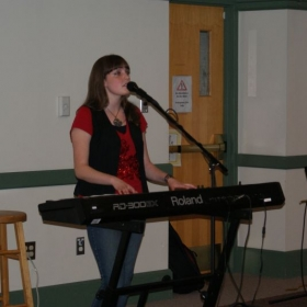 Performing my original music in summer 2012.