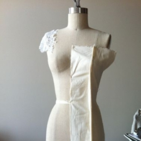 Beginning stages of draping for a sheath style bridal gown.