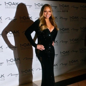 Singer Mariah Carey posing during her red carpet for Mavrix Photo.