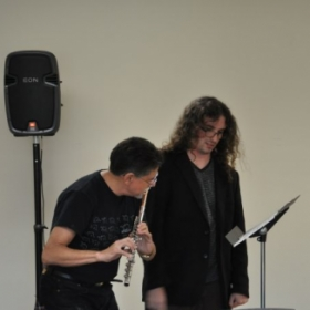 "Coaching renowned flutist Peter Bloom for his performance of ""ED,"" a theatrical work for solo flute"