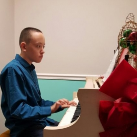 Oscar playing the piano during our Holiday Recital 2016!