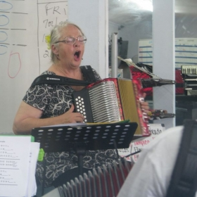 Shelia - always caught with her mouth open!! This is a diatonic class at Houston Accordion Performers studios.