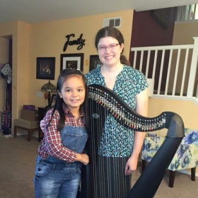 Me with my wonderful harp student, Love.