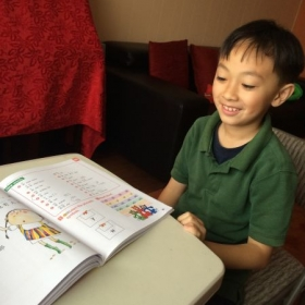 Chinese lesson to an elementary student.