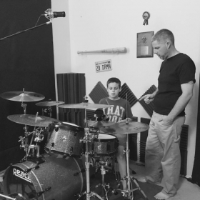 MichEal working with a young student in his home studio