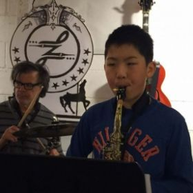 playing Drums with Alto Saxophone Student Charl L.
