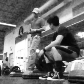 Teaching a friend to deadlift.