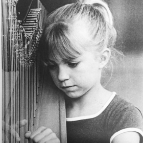 Stephanie as a harp student, age 8