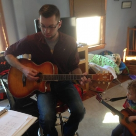 Another vocal student, showing off his guitar skills.