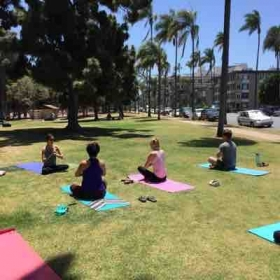 Teaching some lunch time yoga out of the office and in the park!