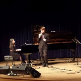 Here's a flashback to me singing at my college's Vocal Jazz Concert.