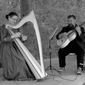 Anne and friend, Chris Kohut playing folk music on the harp