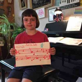 This little 8 year old composed her first piece of music as she understands it.  Very very good!!