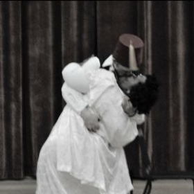 "Kissing scene from the operetta ""Die fledermaus ."""