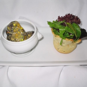 Pistachio escargot, foccicia crisp, fresh greens