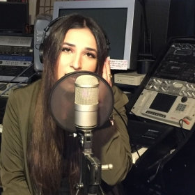Recording a video for youtube for my piano, voice and songwriting student Alineh