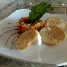 Tomato salad, garlic crostini, chevre, balsmic reduction