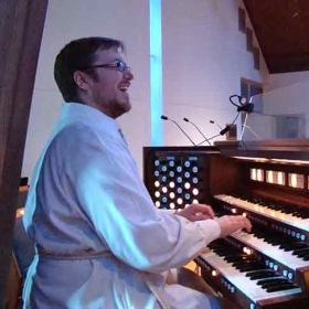 Leading music from the organ at St. John's Evangelical Lutheran Church in Rockville. Photo by Marty Barrick.