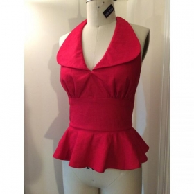 Red 1970s inspired halter with peplum and collar. Ties at waist and neck.