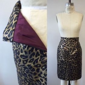 Gold denim foil lined skirt with back vent, waistband, zipper and hook and eye.