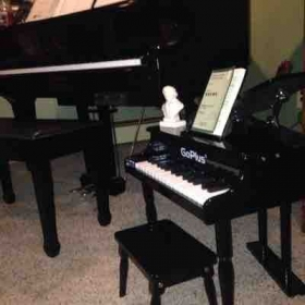 Mine and my daughter's pianos :)