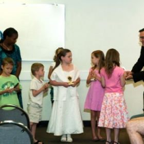 Handing out trophies during the 2011 Recital