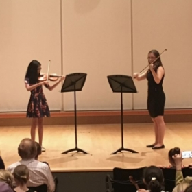 Performing a duet with one of my students at our May 2016 recital.