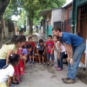 """This is a picture of myself doing an outdoor english class when I lived in El Salvador. We were singing, """"Head, shoulders, knees and toes."""""""