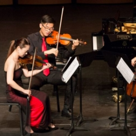Lucy playing in a string quartet concert.