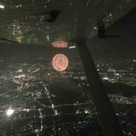 Flying over a fireworks show in Tokyo, Japan. They have dozens of fireworks festivals all summer long across the country!