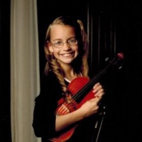 Alexandra in sixth grade with the youth violin group Pizzicato Strings