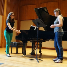Teaching classical singing at a masterclass.