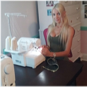 One of my students using her serger to create clothes from her own line.
