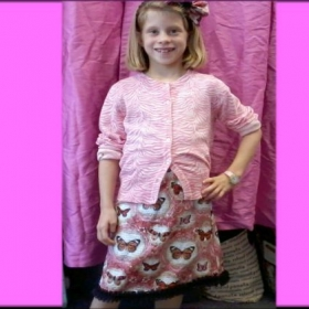 One of my students, 8 years old. She made the skirt with ruffles and matching bow.