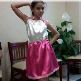 One of my students.She is modeling the outfit she made.
