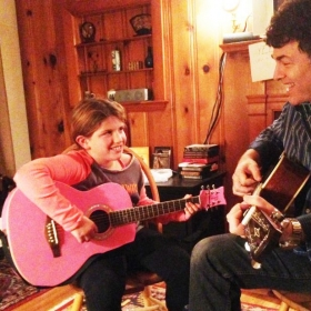 Bob Wolfman with one of his enthusiastic young guitar students.......and how about that PINK guitar?!?