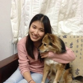 A picture of me with my favorite dog on earth back in Beijing.