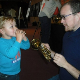 Teaching a VERY young student at an instrument petting zoo in Germantown, TN.
