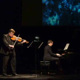 Me performing at the Capitol Theatre in Windsor, Canada with Roman Kosarev, principal violist of the Windsor Symphony.