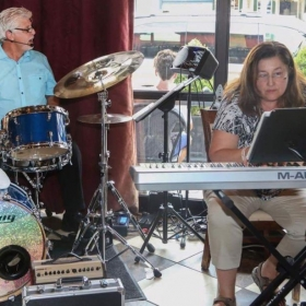 Playing my original keyboard music at a private party for a good friend in NJ  , with Chris B . on drums and vocals. In August 2016.