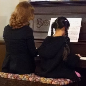 Playing the piano with one of my student's at a Christmas recital 2014