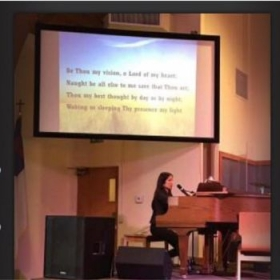 """Janice is at Lao Baptist church performing """"Be Thou My Vision,"""" Selah's contemporary version of an old favorite hymn."""