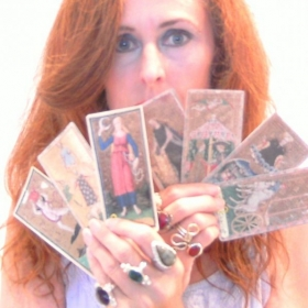 "I can teach you the meanings of the tarot cards, how to lay out ""spreads"" as metaphysical tools."