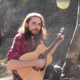 Playing guitar at the park